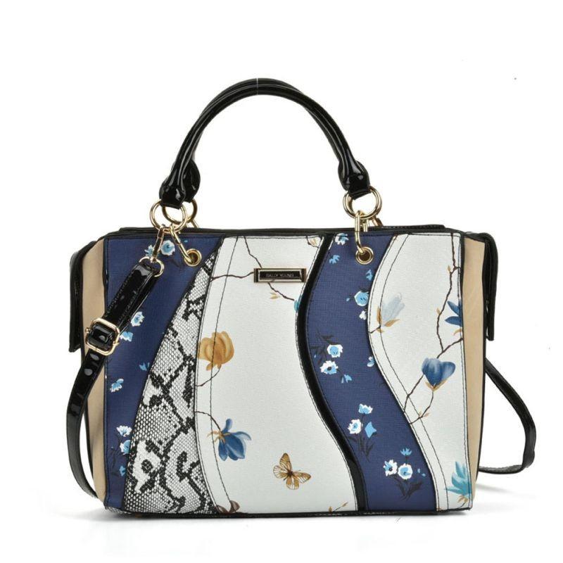 Modrá kabelka do ruky s bielym podkladom. Zadná časť kabelky je čiernej farby. Zapínanie je na zips. Má viacero úložných miest.